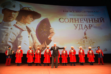 sunstroke: MOSCOW - OCTOBER,7 : N. Mikhalkov with Cossack Choir. Premiere of the movie Solnechny Udar, October,7 , 2014 at Octyabr Cinema in Moscow, Russia Editorial