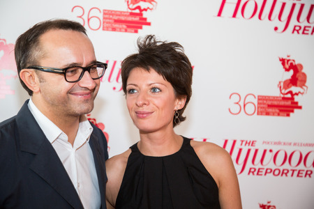 june 25: MOSCOW - JUNE, 25: Film Director Andrey Zvyagintsev (Film Leviathan) with wife. White party Hollywood Reporter Magazine at River Restorant, June 25, 2014 in Moscow, Russia Editorial