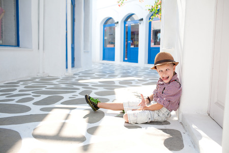 handsome boys: Funny child. Fashionable little boy in sunglasses and hat. Santorini Park