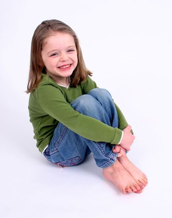 successor: Cute little girl smiling on a white background