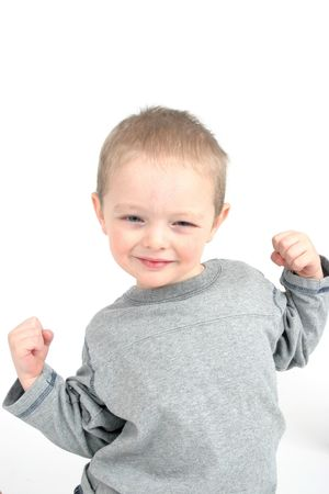 successor: Cute little boy showing muscles Stock Photo