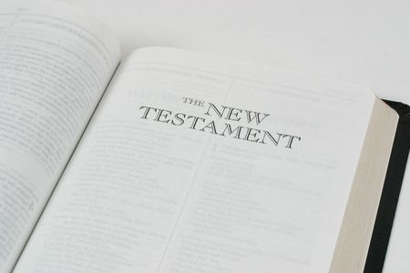writing western: Bible open to the New Testament