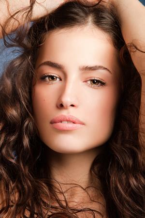 face close up: beautiful long hair woman face, close up