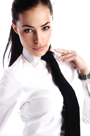 beautiful young business woman in white shirt with tie, studio white