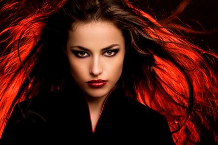 beautiful long hair young woman portait with dark makeup, studio Stock Photo