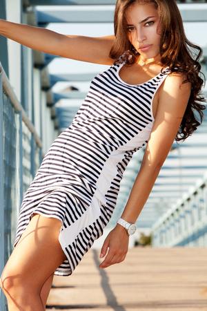 summer dress: beautiful tanned woman in summer dress outdoors shot, summer day