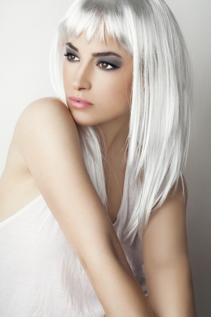 beautiful young woman with modern platinum gray hairstyle