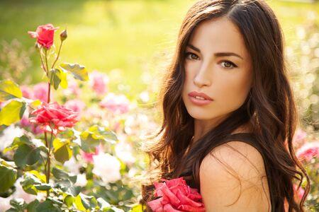beautiful brunette woman in flower garden