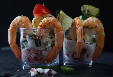 stylish appetizer on skewers with shrimp and avocado