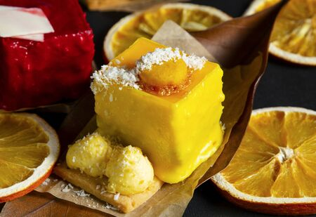 stylish fashionable assortment of lemon raspberry cake and orange