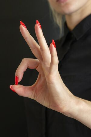 combination of fingers means ok women brush Archivio Fotografico