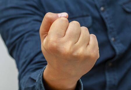 gesture, fist hand symbol means threat