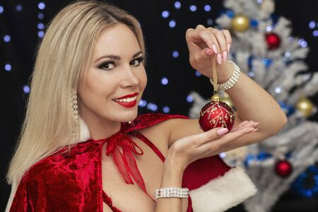 beautiful blonde girl in New Year s costume with a New Year toy Reklamní fotografie