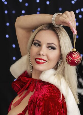 beautiful blonde girl in New Year s costume with a New Year toy
