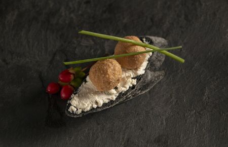 stylish new canapes with foie gras on the black bread with white curd spread