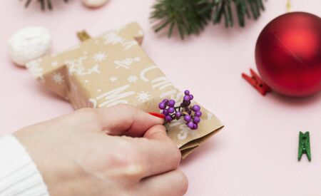 handmade, beautiful simple wrapping gift for the holidays on paper with the inscription Christmas