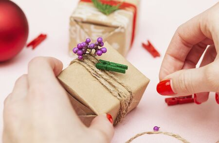 handmade decorations for the holiday, gift wrapping, girl packs gift Stock Photo