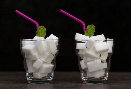 glass filled with pieces of white sugar, cocktail with sugar,