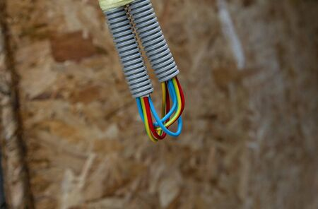 building house electrical wiring in an isolated corrugation
