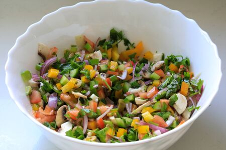 Bowl with chopped vegetable salad.