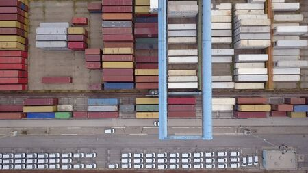 Aerial view on a Port, docking vessels on the platform, containers, and rows of imported new cars. Reklamní fotografie