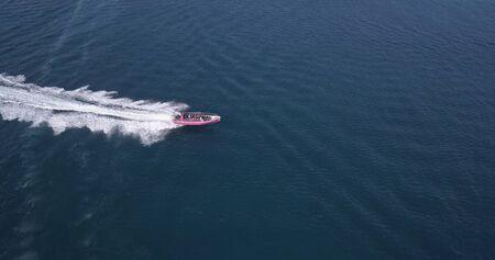 Aerial view of luxury motor boat racing on the water.
