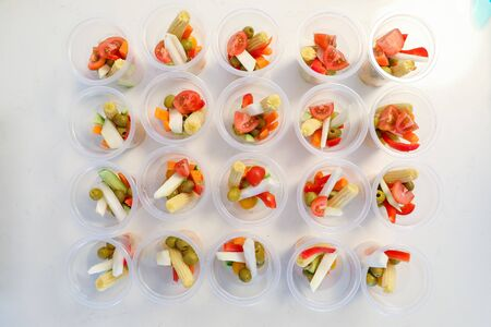 Personalized vegetables in plastic cups. Safe Refreshments in the days of coronavirus. Reklamní fotografie