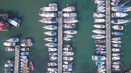 Marina with anchor Yachts and Sailboat. Aerial view.