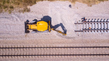 Railroad workers repairing a broken track. Repairing railway. Rail tracks maintenance process. 写真素材