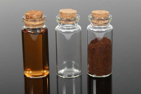 Number of small glass bottles with powders and liquids.