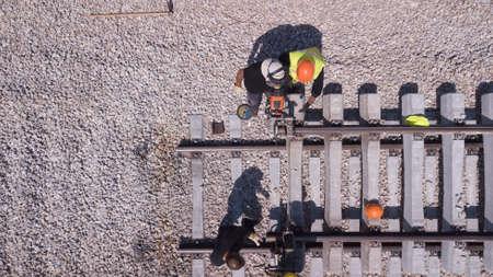Rail tracks maintenance process. Railroad workers repairing a broken track. Repairing railway.