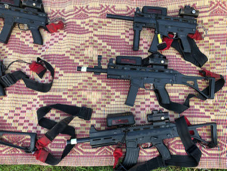 Several guns rifles are lying on the floor. Stock Photo