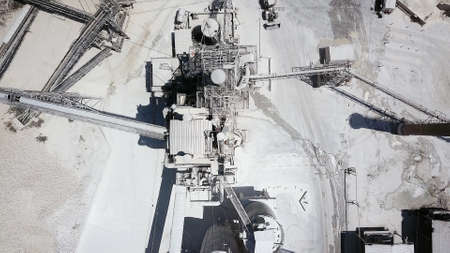large Quarry Stone sorting conveyor belts and an open pit mine.