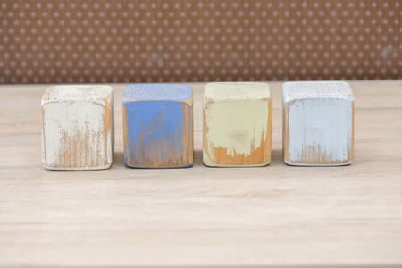 Wooden blocks on a wooden surface and a brown background. 스톡 콘텐츠