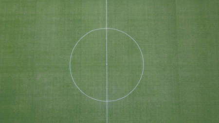 Aerial view of a center of soccer field. Centerline on grass of soccer and football field.