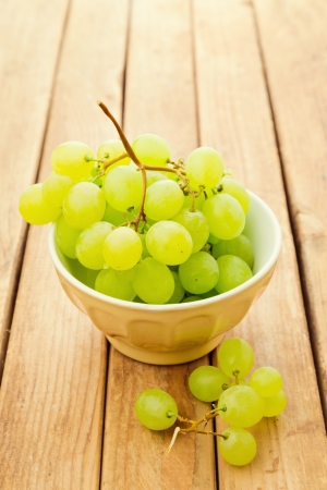 Grapes in bowl over wooden background Stock Photo - 20814904