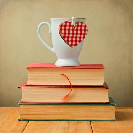 Coffee mug with heart shape on vintage books Stock Photo - 20959739