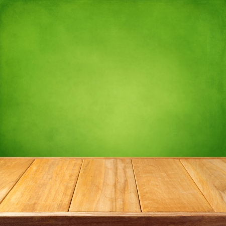 display: Summer background with wooden empty table and green grunge wallpaper