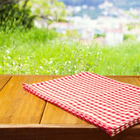 Background for product montage with tablecloth on wooden table photo