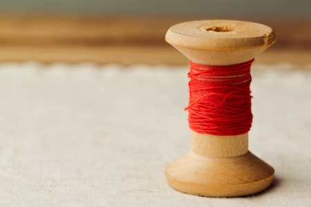 Close up of vintage red thread