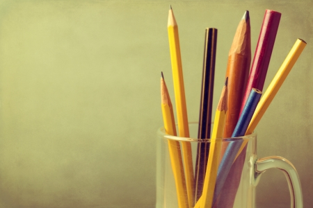 Close up of vintage pencils in glass over grunge background with copy space Stock Photo - 21197556