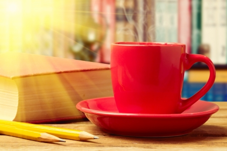 Red coffee cup with books and pencils Stock Photo - 21197579