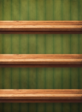 Vintage wooden kitchen shelves over grunge green wallpaper. Ready for product montage display Stock Photo - 21197588