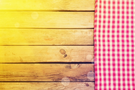 Background with wooden deck table and checked tablecloth Stock Photo