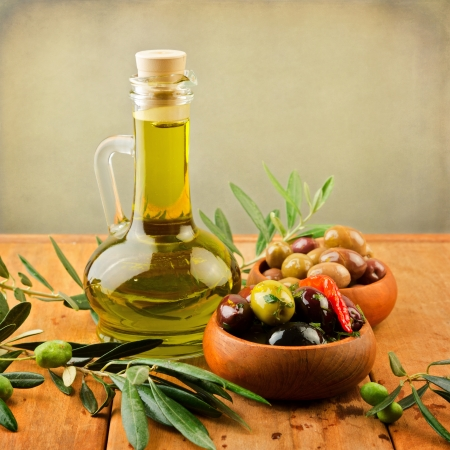 Marinated olives with oil in wooden plates Stock Photo - 21716965