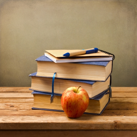 Stack of books with note book and apple  Back to school concept Stock Photo - 21736237
