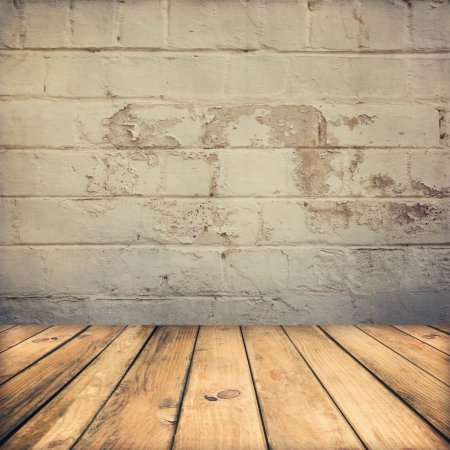 Wooden deck floor and stone grunge wall Stock Photo
