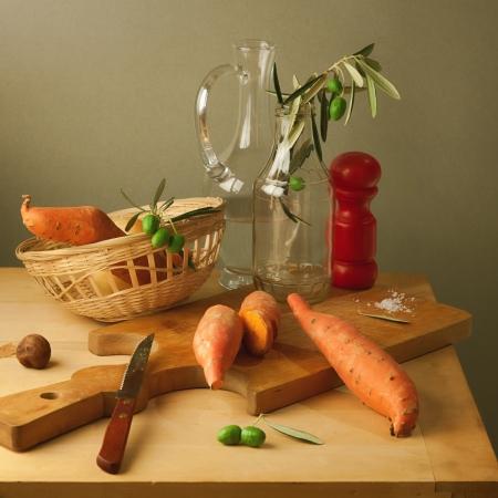 potato tree: Still life with sweet potato on wooden table Stock Photo