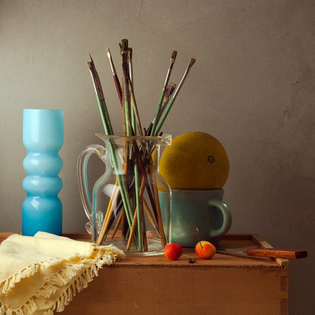 arrangment: Still life with brushes, melon and blue vase