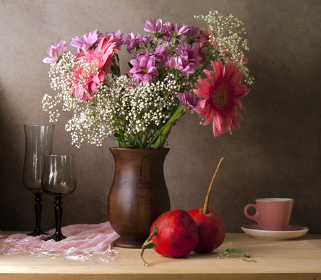 floral arrangements: Classical still life with flowers and pomegranate Stock Photo